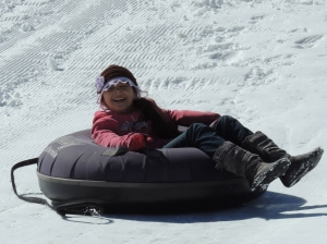 Emily flies down the hill at the Tubing Park.