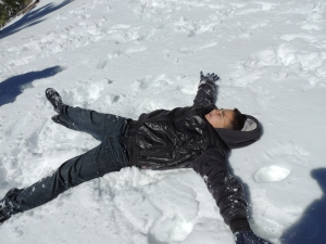 Hunter makes a snow angel.