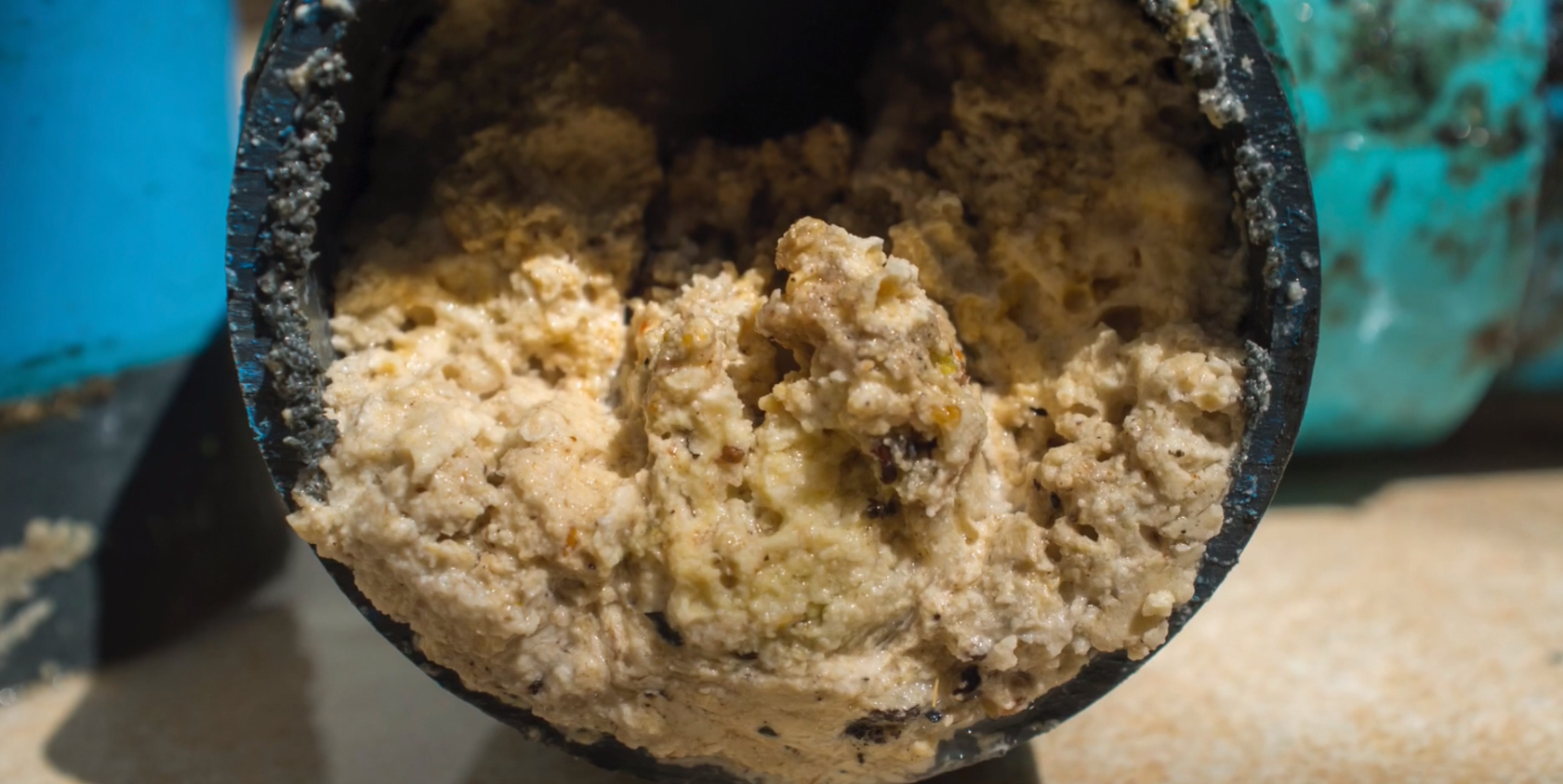 Image of FOG fats, oils, grease clogged in large pipe